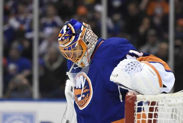 New York Islanders goalie Jaroslav Halak looks on