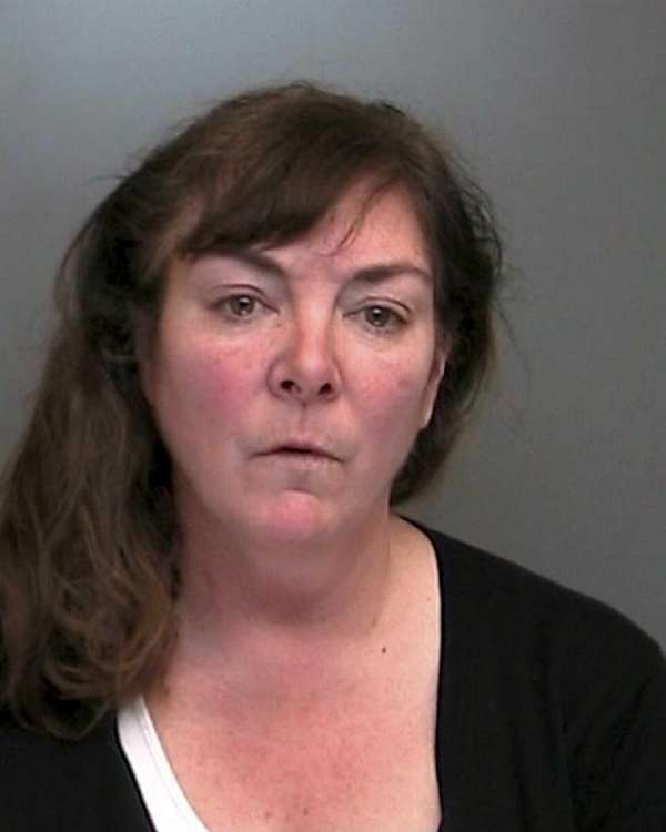 Theresa Finnin-Hunt, 52, of Sea Cliff, was arrested