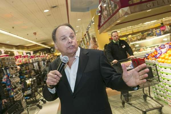 Tony Della, 66, walks around Uncle Giuseppe's Marketplace