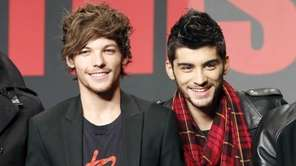 One Direction members Louis Tomlinson, left, and Zayn