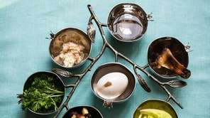 A branch-themed seder plate from ?The New Passover