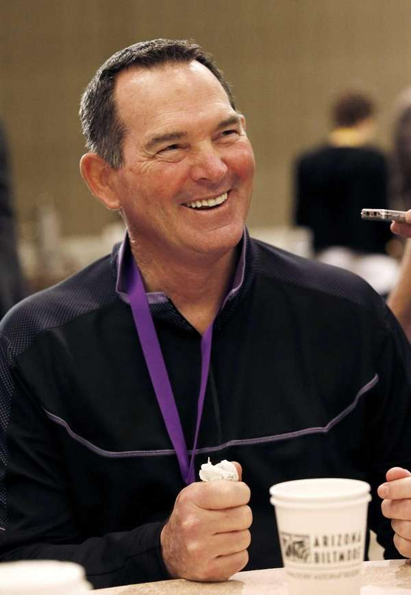 Minnesota Vikings head coach Mike Zimmer smiles as