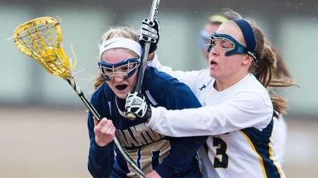 Bayport-Blue Point midfielder/attacker Nicole Copping is defended by