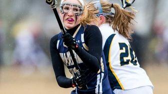 Bayport-Blue Point midfielder/attacker Julia Imbo gets past West