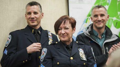 Southampton Town Police Lt. Susan Ralph, center, is