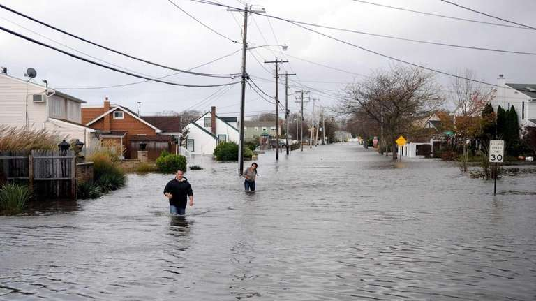 Residents try to flee flooded Shore Road in