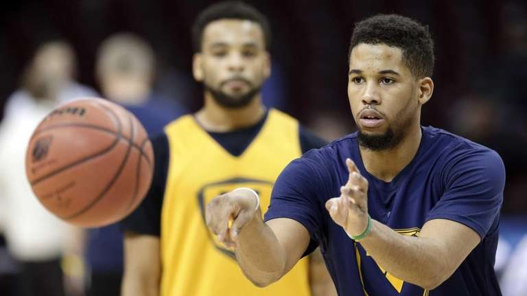 West Virginia's Gary Browne passes during practice for