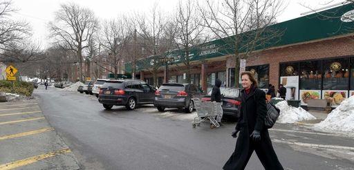 Great Neck Plaza Mayor Jean Celender crosses a