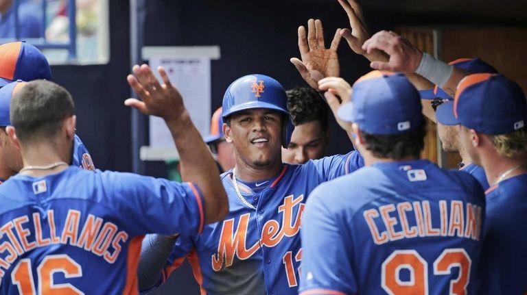 Teammates congratulate New York Mets centerfielder Juan Lagares