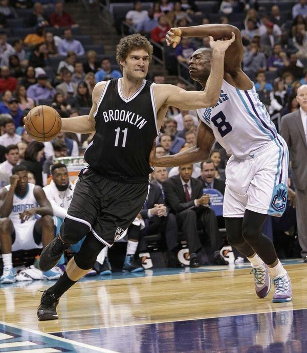 Brooklyn Nets' Brook Lopez drives past Charlotte Hornets'