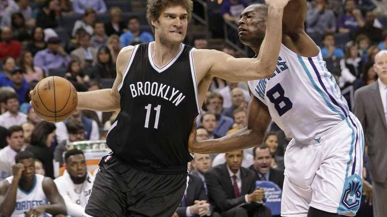 Brooklyn Nets' Brook Lopez drives past Charlotte Hornets'