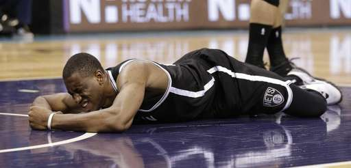 The Brooklyn Nets' Thaddeus Young lays on the