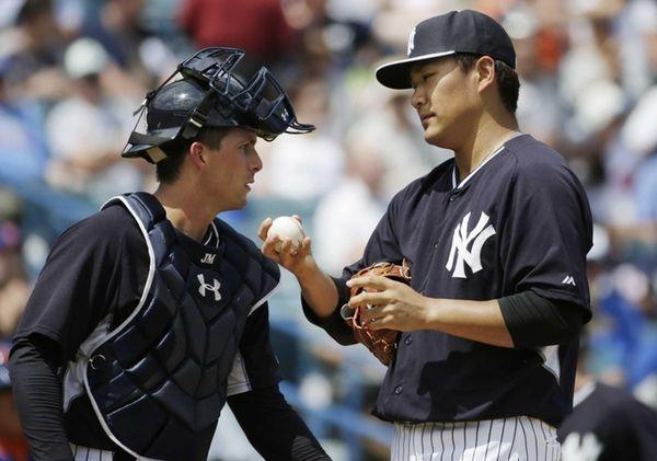 New York Yankees catcher John Ryan Murphy consoles