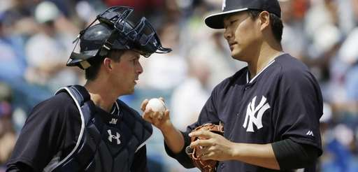 New York Yankees catcher John Ryan Murphy consoles