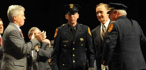 Suffolk County police officer Nicholas Guerrero, is congratulated