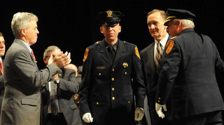 Suffolk County police officer Nicholas Guerrero, is congratulated