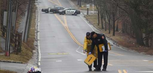 Police investigate the scene on Lakeville Road in
