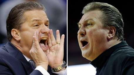 Kentucky head coach John Calipari, left, shouts instructions