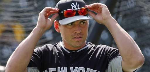 The Yankees' Jacoby Ellsbury adjusts his sunglasses before