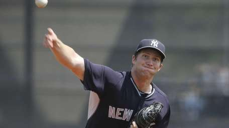 Yankees pitcher Adam Warren delivers against the Tampa