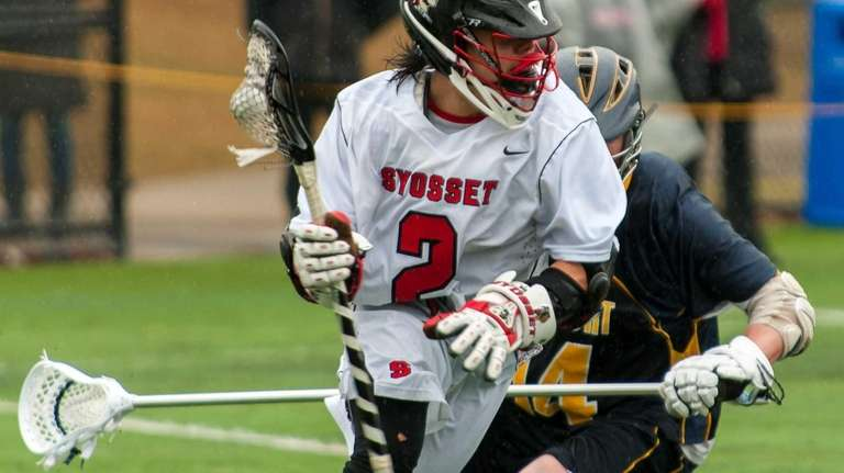 Syosset's Alex Concannon, front, gets around Northport's Rob