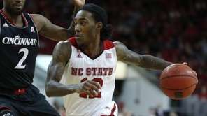 North Carolina State's Cat Barber (12) drives around