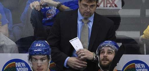 New York Islanders head coach Jack Capuano looks
