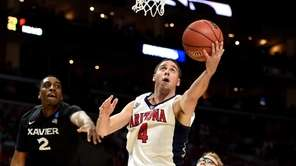 T.J. McConnell of the Arizona Wildcats goes up