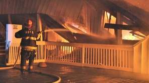Firefighters battle a blaze in Cherry Grove on