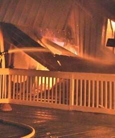 Firefighters battle a fire in the Cherry Grove
