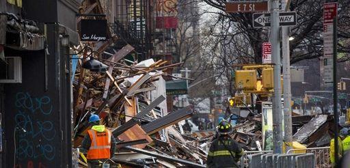 Debris lay in the sidewalk in the wake