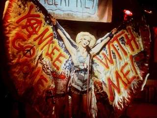 John Cameron Mitchell is shown in a scene