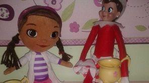 Doc McStuffins with Elf on a Shelf.