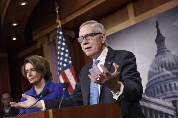 Senate Minority Leader Harry Reid of Nev., accompanied