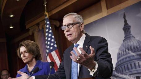 Senate Minority Leader Harry Reid of Nev., accompanied
