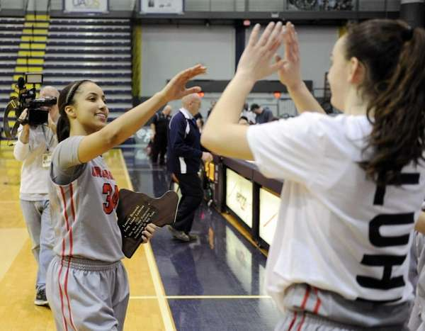 Long Island Lutheran's Boogie Brozoski is greeted by
