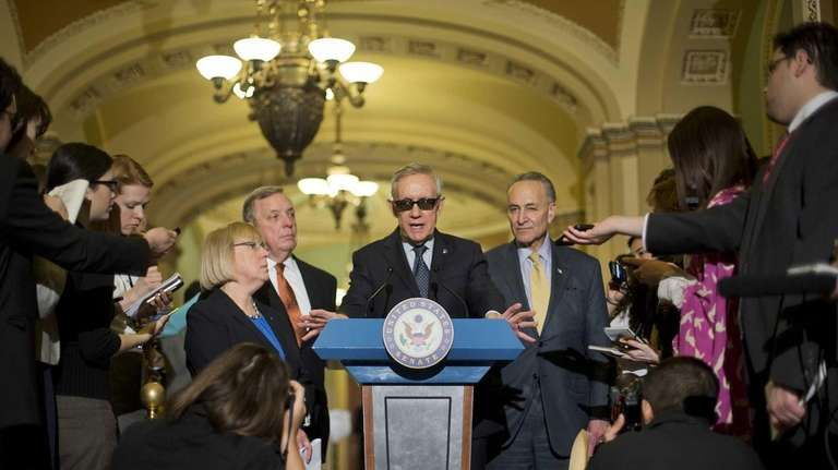 Senate Minority Leader Harry Reid of Nev., center,
