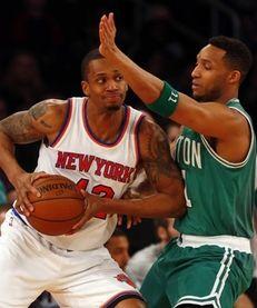 Lance Thomas of the New York Knicks controls