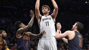 Brooklyn Nets center Brook Lopez is defended bt