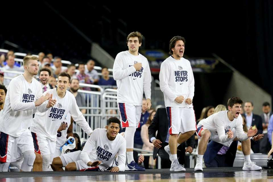 The Gonzaga Bulldogs bench reacts against the UCLA