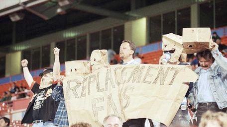 Baseball fans from left, Michael Glass, Jason Andrade,