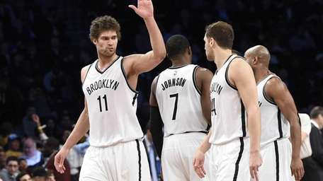 The Brooklyn Nets including center Brook Lopez, left,