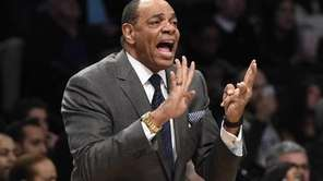 Brooklyn Nets head coach Lionel Hollins directs his