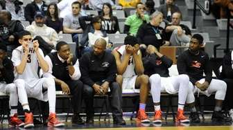 Long Island Lutheran players react after their 50-44