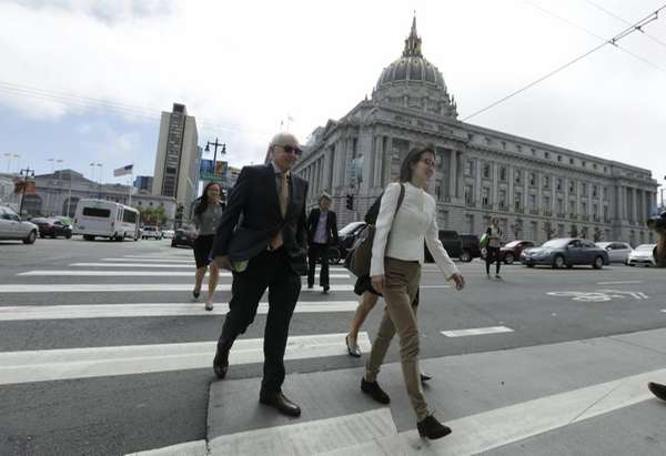 Ellen Pao, right, walks to Civic Center Courthouse