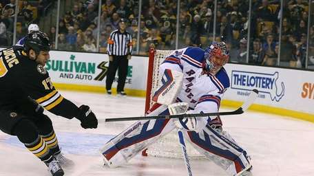 Henrik Lundqvist of the New York Rangers defends