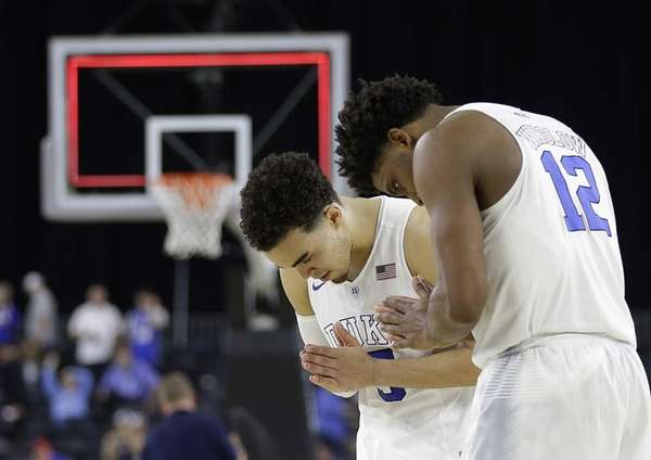 Duke's Justise Winslow (12) and Tyus Jones (5)