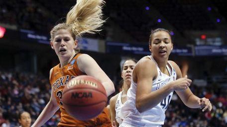 Texas forward Sara Hattis, left, and Connecticut center