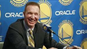 Former Golden State Warriors player Chris Mullin laughs