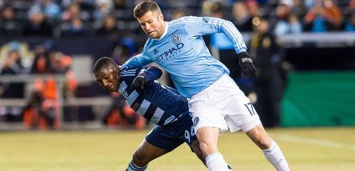 Sporting KC midfielder Jimmy Medranda and New York